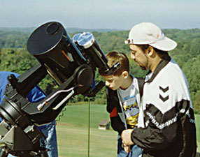 My son Ryan and I looking at H-Alpha flares on the Sun