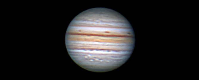 Jupiter with a Wolf pack of White Ovals, below the Southern Equatorial belt of the Jovian cloud tops,