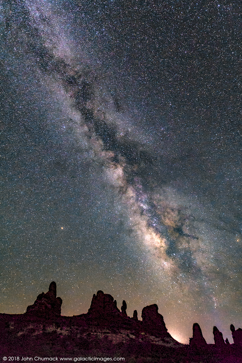 The Milky Way with Mars & Saturn over the rock spires at Arches National Park in Moab Utah.